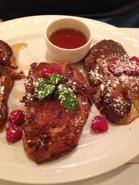 Greek Toast - Estia's version of French toast made with Tsoureki and served with maple syrup and fresh berries